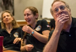 New Horizons team members watch first incoming images of Pluto, July 14 23015.